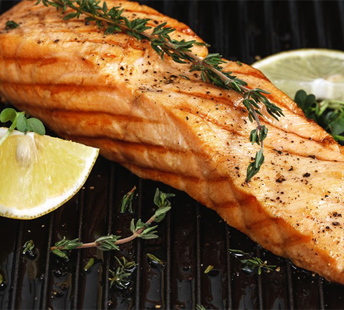 Grilled salmon with rosemary and lemon on the grate