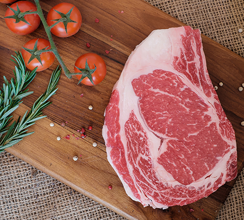 Top view of prime dry aged tender ribeye steak